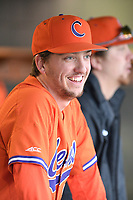 Pitcher Mat Clark (20) of the Clemson Tigers waits in the dugout between innings of a game against the South Alabama Jaguars on Opening Day, Friday, February 15, 2019, at Doug Kingsmore Stadium in Clemson, South Carolina. Clemson won, 6-2. (Tom Priddy/Four Seam Images)
