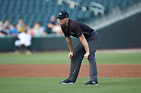 Third base umpire Adam Beck works the International League game between the Gwinnett Braves and the Charlotte Knights at BB&T BallPark on July 14, 2019 in Charlotte, North Carolina.  The Stripers defeated the Knights 5-4. (Brian Westerholt/Four Seam Images)