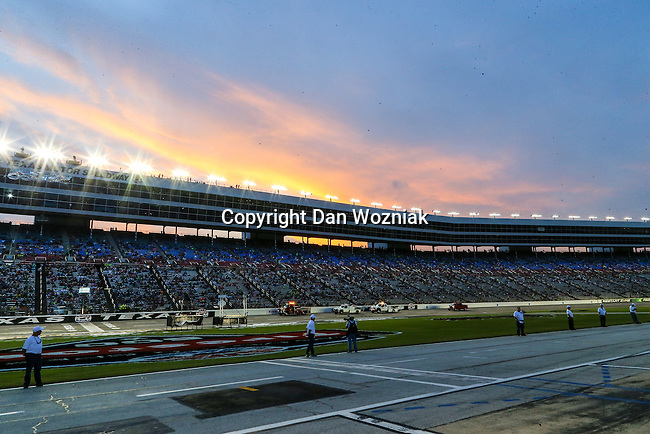 Texas Motor Speedway workers dry the track before the Verizon Indy Car Firestone 600 race at Texas Motor Speedway in Fort Worth,Texas.