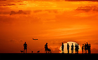 A group of onlookers enjoying anunforgettable sunset.
