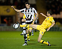 ST MIRREN'S STEVEN THOMPSON IS CHALLENGED BY AYR UNITED'S JOHN ROBERTSON