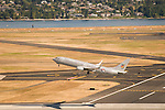 Aerial view of an Alaska Airlines commercial flight during takeoff at the PDX.