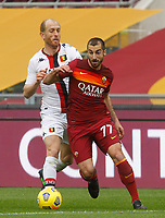 Roma's Henrikh Mkhitaryan, right, is chased by Genoa's Andrea Masiello during the Italian Serie A Football match between Roma and Genoa at Rome's Olympic stadium, March 7, 2021.<br /> UPDATE IMAGES PRESS/Riccardo De Luca