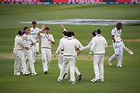 The Black Caps congratulate Will Young for catching Kraigg Brathwaite off bowler Trent Boult during day three of the second International Test Cricket match between the New Zealand Black Caps and West Indies at the Basin Reserve in Wellington, New Zealand on Sunday, 13 December 2020. Photo: Dave Lintott / lintottphoto.co.nz
