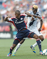 New England Revolution defender Jose Goncalves (23) shields ball from LA Galaxy forward Gyasi Zardes (29). In a Major League Soccer (MLS) match, the New England Revolution (blue) defeated LA Galaxy (white), 5-0, at Gillette Stadium on June 2, 2013.