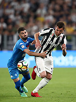 Calcio, Serie A: Juventus - Napoli, Torino, Allianz Stadium, 22 aprile, 2018.<br /> Napoli's Elseid Hysaj (l) in action with Mario Mandzukic (r) during the Italian Serie A football match between Juventus and Napoli at Torino's Allianz stadium, April 22, 2018.<br /> UPDATE IMAGES PRESS/Isabella Bonotto