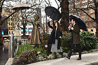 """Zizi Strallen and Alex Zane unveils a Mary Poppins statue at the launch of """"Scenes in the Square"""" statue trail in Leicester Square, London.<br /> <br /> ©Ash Knotek  D3558 27/02/2020"""