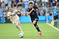 KANSAS CITY, KS - JUNE 26: Daniel Salloi #20 Sporting KC with the ball during a game between Los Angeles FC and Sporting Kansas City at Children's Mercy Park on June 26, 2021 in Kansas City, Kansas.