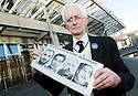 "Dr Jim Swire, whose daughter Flora died when Pan Am Flight 103 crashed on the town of Lockerbie, Scotland, holds photographs of the men that he believes were responsible.     <br /> Dr Swire was at the Scottish Parliament<br /> to watch the premiere of Al Jazeera's, ""Lockerbie: What Really Happened?""."