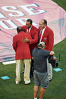 Joe Morgan hugs Barry Larkin as Johnny Bench looks on during the Franchise Four introductions before the MLB All-Star Game on July 14, 2015 at Great American Ball Park in Cincinnati, Ohio.  (Mike Janes/Four Seam Images)