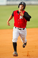 Joey DeMichele (17) of the Kannapolis Intimidators hustles into third base with a triple against the Rome Braves at CMC-Northeast Stadium on August 5, 2012 in Kannapolis, North Carolina.  The Intimidators defeated the Braves 9-1.  (Brian Westerholt/Four Seam Images)