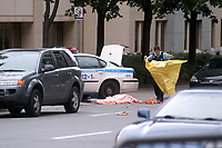 September 13, 2006 File Photo - Montreal policemen on the scene of a shooting at Dawson college.<br /> 19 student were wounded and 1 was killed by Kimveer Gill, who  commited suicide after beeing wound by the police<br /> <br /> Photo : (c) Rob Gallbraith, 2006