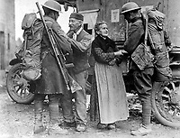 An old  French couple, M. and Mme. Baloux of Brieulles-sur-Bar, France, under German occupation for four years, greeting soldiers of the 308th and 166th Infantries upon their arrival during the American advance.  November 6, 1918.  Lt. Adrian C. Duff. (Army)<br />NARA FILE #:  111-SC-32080<br />WAR & CONFLICT BOOK #:  683