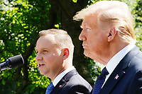 US President Donald J. Trump (R) and Polish President Andrzej Duda hold a joint press conference in the Rose Garden of the White House in Washington, DC, USA, 24 June 2020. Duda, a conservative nationalist facing a tight re-election race back home, is the first foreign leader to visit the White House in more than three months.<br /> Credit: Jim LoScalzo / Pool via CNP/AdMedia