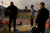 Donets'k.July 30, 2005..Football match ?Shakhtar? (1)-?Krivbas?(0) in the ?Olimpiysky? stadium. The team is owned by Rinat Akhmetov is the richest Ukrainian businessman/oligarch...Security is very tight and in place in case of any signs of violence. These police and security guards protect the visiting team's fans. .......