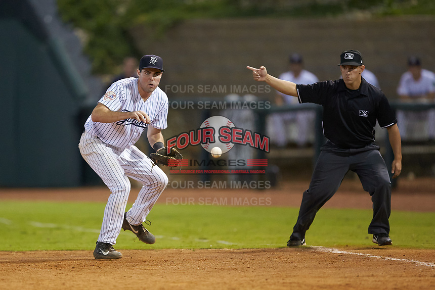 Pulaski Yankees first baseman Jake Farrell (72) tracks a ground ball as first base umpire Mickey Smith indicates a fair ball during the game against the Burlington Royals at Calfee Park on September 1, 2019 in Pulaski, Virginia. The Royals defeated the Yankees 5-4 in 17 innings. (Brian Westerholt/Four Seam Images)