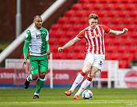 5th April 2021; Bet365 Stadium, Stoke, Staffordshire, England; English Football League Championship Football, Stoke City versus Millwall; Harry Souttar of Stoke City breaks away from Kenneth Zohore of Millwall