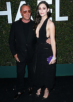 BEVERLY HILLS, CA, USA - OCTOBER 02: Michael Kors, Emmy Rossum arrive at Michael Kors Launch Of Claiborne Swanson Franks's 'Young Hollywood' Book held at a Private Residence on October 2, 2014 in Beverly Hills, California, United States. (Photo by Xavier Collin/Celebrity Monitor)