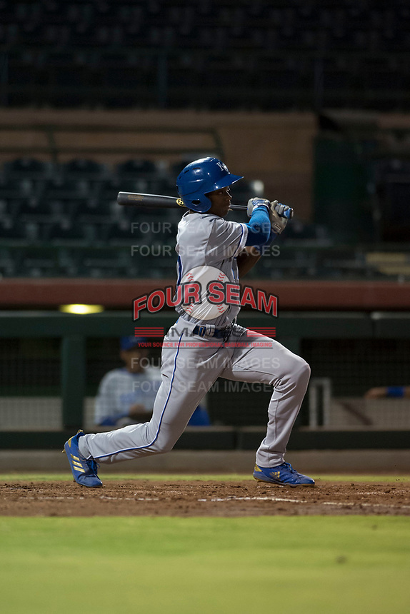 AZL Royals left fielder Isaiah Henry (17) follows through on his swing during an Arizona League game against the AZL Giants Black at Scottsdale Stadium on August 7, 2018 in Scottsdale, Arizona. The AZL Giants Black defeated the AZL Royals by a score of 2-1. (Zachary Lucy/Four Seam Images)