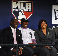 Outfielder Courtney Hawkins (Carroll H.S.) the number thirteen overall pick to the Chicago White Sox with his mom and dad during the MLB Draft on Monday June 04,2012 at Studio 42 in Secaucus, NJ.   (Tomasso DeRosa/ Four Seam Images)