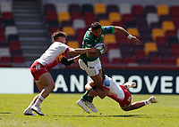 24th April 2021; Brentford Community Stadium, London, England; Gallagher Premiership Rugby, London Irish versus Harlequins; Curtis Rona of London Irish tackled by Joe Marchant and Cadan Murley of Harlequins