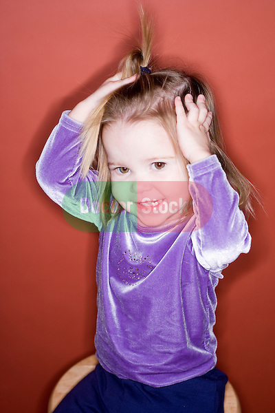 young boy blows a blue bubble against a blue background..Model Released