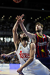 Real Madrid´s Sergio Llull and Barcelona´s Tomic during Liga Endesa Final first match at Palacio de los Deportes in Madrid, Spain. June 19, 2015. (ALTERPHOTOS/Victor Blanco)