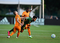 LAKE BUENA VISTA, FL - JULY 18: Eryk Williamson #30 of the Portland Timbers is fouled by Aljaz Struna #5 of the Houston Dynamo as Darwin Quintero #23 of the Houston Dynamo looks on during a game between Houston Dynamo and Portland Timbers at ESPN Wide World of Sports on July 18, 2020 in Lake Buena Vista, Florida.