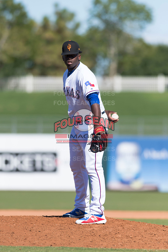 Surprise Saguaros relief pitcher Demarcus Evans (30), of the Texas Rangers organization, looks in for the sign during an Arizona Fall League game against the Peoria Javelinas at Surprise Stadium on October 17, 2018 in Surprise, Arizona. (Zachary Lucy/Four Seam Images)