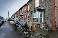 Pictured: Furniture and other items damaged by the flood are left outside a house in Oxford Street. Monday 17 February 2020<br /> Re: Cleanup after storm Dennis in Oxford Street, Nantgarw, Wales, UK.
