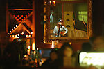 Lauris Vidal <cq>, plays on a guitar during open mic night Thursday, December 6, 2007, at Caffe Da Vinci in DeLand. Lauris Vidal <cq>, a local musician, is the MC for the Thursday open mic night. Caffe Da Vinci is a night spot that regularly has live bands, the Tongue and Groove Art Gallery and is connected to Florida Victorian Architectural Antiques. The serve a mix of imported beers, wines and coffee. (Daytona Beach News-Journal, Chad Pilster)