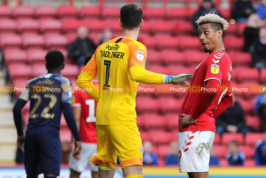 Charlton Athletic striker, Lyle Taylor, smiles and pulls a face as he looks towards the Barnsley supporters who had been barracking him during Charlton Athletic vs Barnsley, Sky Bet EFL Championship Football at The Valley on 1st February 2020