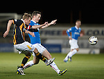 Stevie Campbell clears from Jon Daly