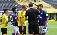16th May 2020, Signal Iduna Park, Dortmund, Germany; Bundesliga football, Borussia Dortmund versus FC Schalke;  Referee Deniz Aytekin speaks sternly to Schalke's Jean-Clair Todibo and  BVB's Erling Haland