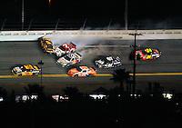 Feb 07, 2009; Daytona Beach, FL, USA; NASCAR Sprint Cup Series driver Jeff Burton (31) races as Joey Logano (20) Scott Speed (82) David Ragan (6) Robby Gordon (7) and Casey Mears (07) crash while Jeff Gordon (24) slows to avoid during the Bud Shootout at Daytona International Speedway. Mandatory Credit: Mark J. Rebilas-