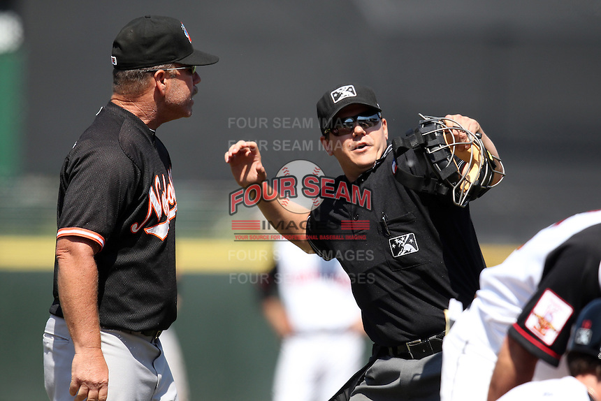 Norfolk Tides manager Gary Allenson #6 is ejected by home plate umpire Gerard Ascani arguing a call during a game against the Rochester Red Wings at Frontier Field on June 5, 2011 in Rochester, New York.  Norfolk defeated Rochester 11-5 in eleven innings.  Photo By Mike Janes/Four Seam Images