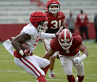 Arkansas running back Raheim Sanders (5) carries the ball Saturday, April 3, 2021, as defensive back Jalen Catalon (1) prepares to make the tackle during a scrimmage at Razorback Stadium in Fayetteville. Visit nwaonline.com/210404Daily/ for today's photo gallery. <br /> (NWA Democrat-Gazette/Andy Shupe)