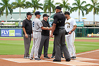 Coach Ryan Hunt (9) and manager Jonathan Johnston (19) meet with umpires Jon-Tyler Shaw, Joe McCarthy, Chandler Durham, and Kenny Jackson during the lineup exchange before Game One of the Low-A Southeast Championship Series between the Tampa Tarpons and Bradenton Marauders on September 21, 2021 at LECOM Park in Bradenton, Florida.  (Mike Janes/Four Seam Images)
