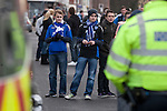 """Portsmouth 1 Southampton 1, 18/12/2012. Fratton Park, Championship. A group of young Portsmouth fans peering through a line of police officers in a street outside Fratton Park stadium before their club take on local rivals Southampton in a Championship fixture. Around 3000 away fans were taken directly to the game in a fleet of buses in a police operation known as the """"coach bubble"""" to avoid the possibility of disorder between rival fans. The match ended in a one-all draw watched by a near capacity crowd of 19,879. Photo by Colin McPherson."""