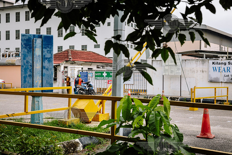An entrance to Kossan Rubber Industries Bhd. The company has temporarily suspended operations at one of its plants in Klang after 427 employees were infected with COVID-19.