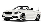 Stock pictures of low aggressive front three quarter view of a 2018 BMW 2 Series Sport 2 Door Convertible