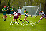 Kerry's Rachel McCarthy get her effort away despite the attemped block by Galway's Laura Glynn  in the National Camogie league in Lixnaw on Saturday.
