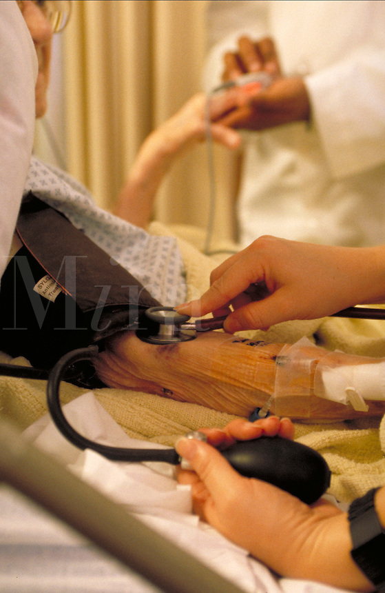 Health Care, hands performing a Blood Pressure Check, Hospital Care, medical equipment, procedures, medicine.