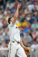 Michigan Wolverines pitcher Willie Weiss (20) points to a fly ball against the Vanderbilt Commodores during Game 2 of the NCAA College World Series Finals on June 25, 2019 at TD Ameritrade Park in Omaha, Nebraska. Vanderbilt defeated Michigan 4-1. (Andrew Woolley/Four Seam Images)