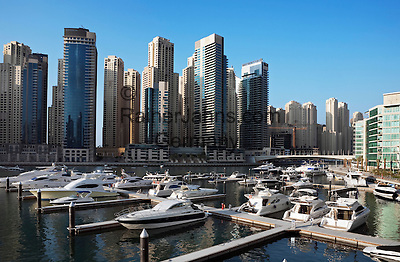 United Arab Emirates, Dubai: Yachts moored in marina with exclusive apartment blocks behind
