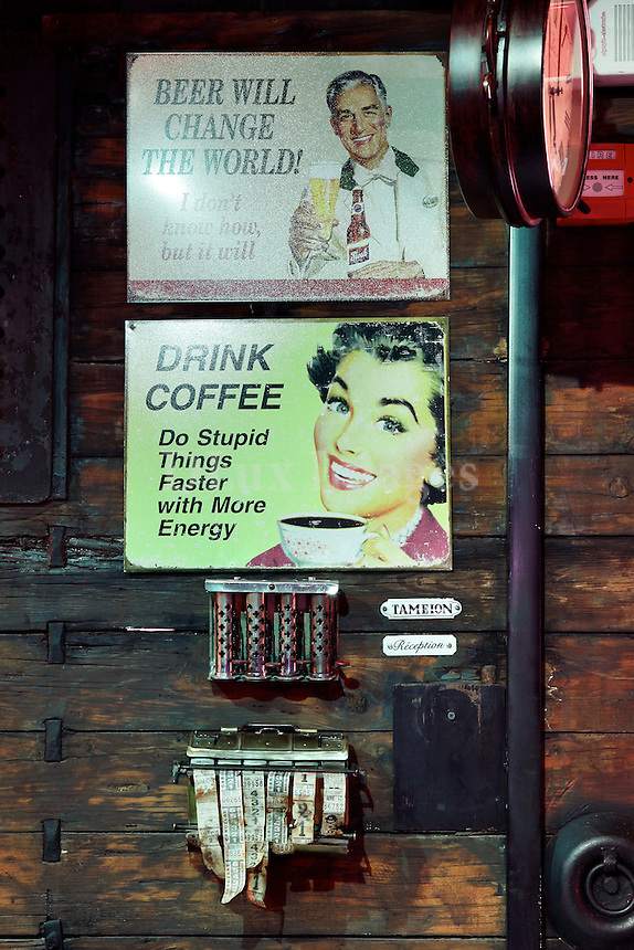 vintage signs on wooden wall