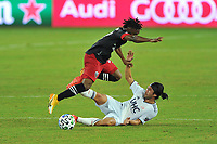 WASHINGTON, DC - SEPTEMBER 27: Lee Nguyen #42 of New England Revolution battles for the ball with Moses Nyeman #27 of D.C. United during a game between New England Revolution and D.C. United at Audi Field on September 27, 2020 in Washington, DC.