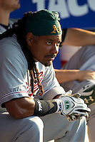 Sacramento River Cats designated hitter Manny Ramirez #11 in the dugout before the Pacific Coast League baseball game against the Round Rock Express on May 22, 2012 at The Dell Diamond in Round Rock, Texas. The Express defeated the River Cats 11-5. (Andrew Woolley/Four Seam Images).
