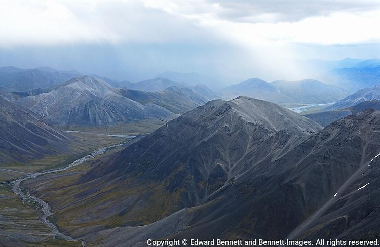 A rainstorm passes over the Brooks Range in Alaska's Arctic National Wildlife Refuge.