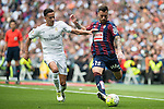 Real Madrid's Lucas Vazquez and Sociedad Deportiva Eibar's Antonio Luna during La Liga match. April 09, 2016. (ALTERPHOTOS/Borja B.Hojas)